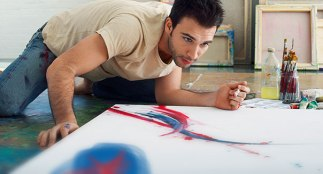 Artist painting on canvas on studio floor. Image shot 2006. Exact date unknown.